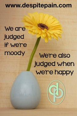 Judges for being moody. Judged for being happy. Flower in vase