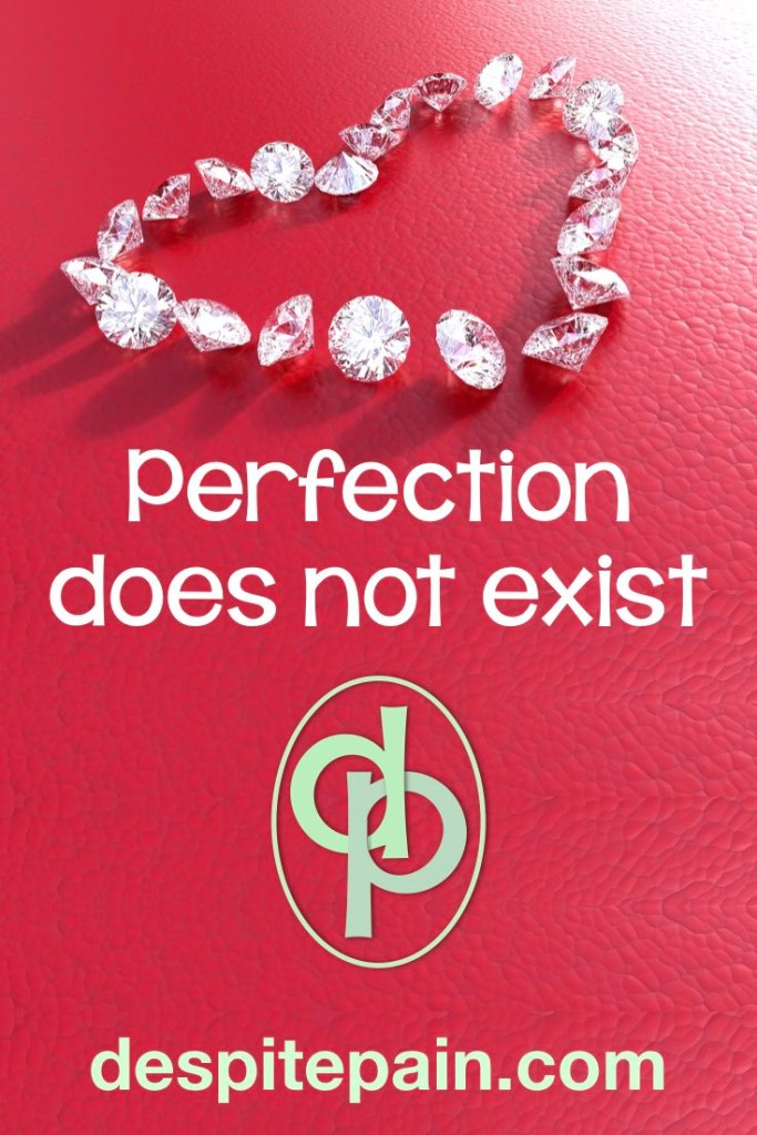 Perfection does not exist. In picture, diamonds in the shape of a heart on red background.